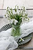 Snowdrops in nostalgic crystal vase