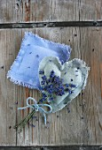 Lavender posy tied with bow lying on two handmade lavender bags