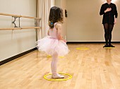 Small girl gets ballet lesson