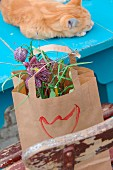 Flower arrangement of snake's head fritillaries in paper bag