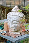 Head of Buddha decorating garden table