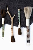 Various paintbrushes on animal skin