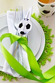 A place setting at a football-themed party