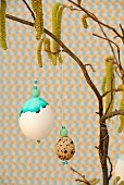 Painted eggs hanging from hazel branch