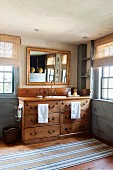 Wooden, vintage-style washstand cabinet with drawers and gilt-framed mirror