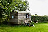 Idyllic shepherd's hut, two women and dog in the country