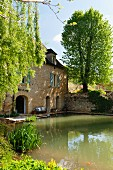 Pond in front of historical mill in the Dordogne