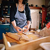A woman making bread, Sweden.