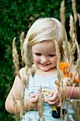 Smiling little girl carrying doll