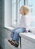 Young Girl Sitting in a Window