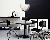 A Black Dining Table and Chairs