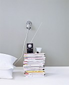 A bedside table made of magazines