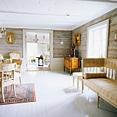 Connected rooms in old, Swedish, wooden house with original, rustic wooden walls and antique furnishings
