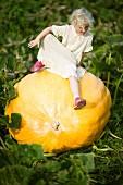 Scandinavian girl on a giant pumpkin, Sweden