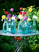 Garden decorated with flowers in glass bottles, Sweden.