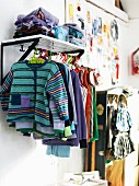 Sweden, clothes on cloth rail in childrens room
