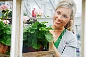 A blond woman working in a flower shop, Sweden