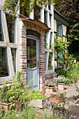 Planters outside rustic house with brick facade