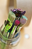 Used paintbrushes in glass jar