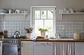 Bright, simple kitchen with white units