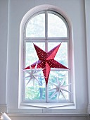 Advent star in arched window