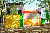 Building with interlocking structure in bold colour scheme