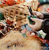 Hand-tying a decorative, autumnal wreath