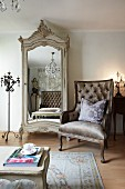Neo-classical armchair next to antique wardrobe with mirrored door