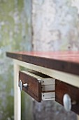 Vintage wooden table with open drawer