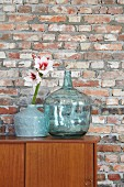 Amaryllis flowers against rustic brick wall