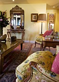 Yellow, Baroque-style living room with ornate wall mirror and gilt coffee table with glass top