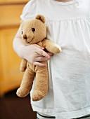 A girl holding a teddybear.