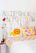 Nursery room with bed and alphabets on wall