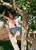 A woman in a tree.