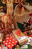 A Christmas goat and Christmas presents.