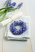Small wreath of grape hyacinths with name tag