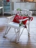 Festively decorated white wooden chair