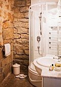 Modern shower & washstand in bathroom with stone walls in manor house (Languedoc, France)