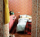 Bed & chest of drawers in bedroom in mixture of patterns