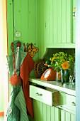 Green wooden kitchen cupboards