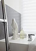 White china parrot on bathtub surround
