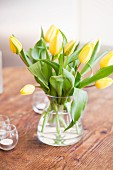 Yellow tulips on table for mother's day brunch
