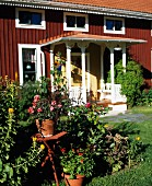 Red, Swedish wooden house with large porch