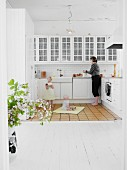 Mother and children in white, Scandinavian-style kitchen