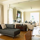 Sofas in long room with stucco ceiling