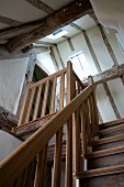 Wooden staircase leading to attic in restored half-timbered house