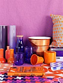 Home accessories in shades of orange & purple