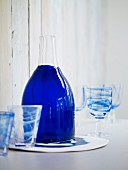 Blue glass carafe and drinking glasses