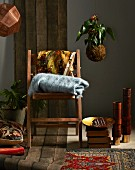 Home accessories in dark shades - wooden chair, blanket, cushion, rug