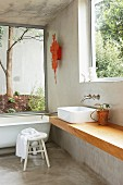 Purist bathroom with large windows in concrete house